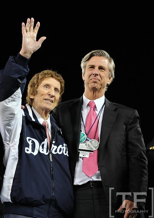 Oct 18, 2012; Detroit, MI, USA; Detroit Tigers owner Mike Ilitch (left), and general manager Dave Dombrowski look out at the crowd from a stage after game four of the 2012 ALCS against the New York Yankees at Comerica Park.  The Tigers won 8-1 to sweep the series and advance to the World Series.  Mandatory Credit: Tim Fuller-USA TODAY Sports