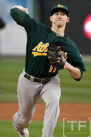 Oct 6, 2012; Detroit, MI, USA; Oakland Athletics starting pitcher Jarrod Parker (11) delivers a pitch during the third inning of game one of the 2012 ALDS against the Detroit Tigers at Comerica Park.  Mandatory Credit: Tim Fuller-US PRESSWIRE