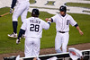 Oct 6, 2012; Detroit, MI, USA; Detroit Tigers second baseman Omar Infante (right) fist bumps first baseman Prince Fielder (28) after scoring a run during the third inning of game one of the 2012 ALDS against the Oakland Athletics at Comerica Park.  Mandatory Credit: Tim Fuller-US PRESSWIRE