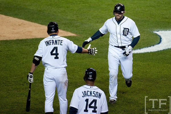 Oct 6, 2012; Detroit, MI, USA; Detroit Tigers catcher Alex Avila (13) celebrates with second baseman Omar Infante (4) and center fielder Austin Jackson (14) after hitting a home run during the fifth inning of game one against the Oakland Athletics of the 2012 ALDS at Comerica Park.  Mandatory Credit: Tim Fuller-US PRESSWIRE