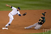 Oct 6, 2012; Detroit, MI, USA; Detroit Tigers second baseman Omar Infante (4) makes a play at second base to force out Oakland Athletics shortstop Cliff Pennington (2) during the fifth inning of game one of the 2012 ALDS at Comerica Park. Mandatory Credit: Tim Fuller-US PRESSWIRE