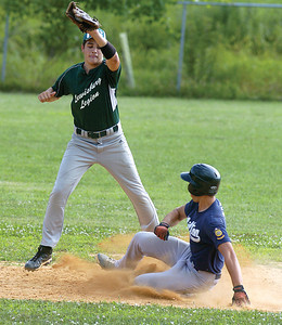 Lewisburg's Mike Fisher tries to reach the bag as Milton's Damian Moyer steals second.