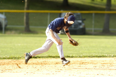 Sunbury-Norry's Nick Dunn stays with the play despite losing his hat during Friday's American Legion game against Selinsgrove.