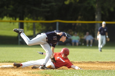 Sunbury-Norry Jon Stetler applies the tag on Selinsgrove's Isaiah Rapp for the out at second base on a close play during Friday's American Legion game.