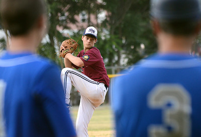 Berwick players keeps an eye on Sunbury/Northumberland's relief pitcher, Nick Dunn, as he warms up during their American Legion playoff game Thursday July 12, 2012 at Pineknotter Park.