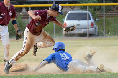 Sunbury/Northumberland's Logan Hall tags out Berwick's Kevin Laubach as he attempts to steal second during their American Legion playoff game Thursday July 12, 2012 at Pineknotter Park.
