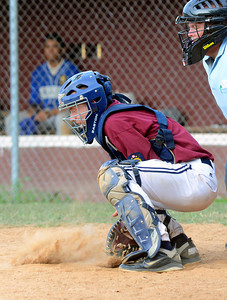 Sunbury/Northumberland's Colby Lahr blocks a wild pitch during their American Legion playoff game against Berwick Thursday July 12, 2012 at Pineknotter Park.