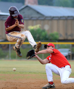 Sunbury/Northumberland's Logan Hall is hit in the air by the throw to Selinsgrove's Alex Moyer at first base during their American Legion playoff game Wednesday July 11, 2012 at Pineknotter Park in Northumberland.