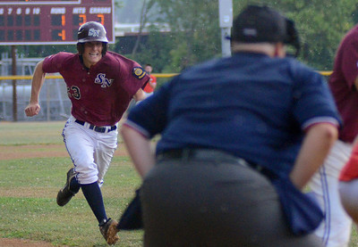 Sunbury/Northumberland's Andrew Eyster moves in to steal home during their American Legion playoff game against Selinsgrove Wednesday July 11, 2012 at Pineknotter Park in Northumberland.