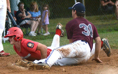 Selinsgrove's Justin Keiser slides under the tag by Sunbury/Northumberland's Jack Snyder to be called safe at home during their American Legion playoff game Wednesday July 11, 2012 at Pineknotter Park in Northumberland.