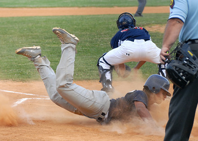 Milton's Reynaldo Adames slides into home ahead of the throw to Watsontown's catcher, Dawson Fox, during their American Legion game Wednesday June 27, 2012.