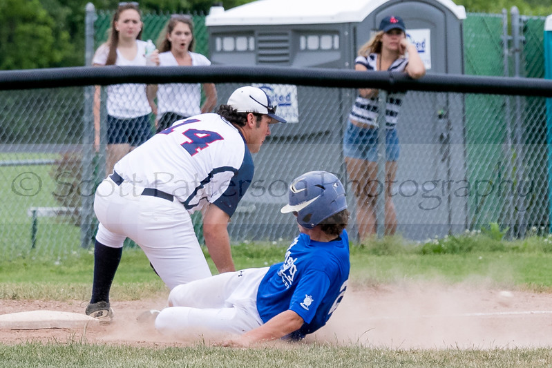 Dover Post 8's Griffin Young attempts to tag Derry Post 9's Brian Sutton as he safely slides into third base during Senior American Legion Baseball Monday night in Dover. Photo by Scott Patterson/Fosters.com