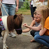 Cortney and Morgan Burns from Lunenburg like the miniature therapy horse