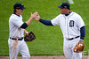 Oct 7, 2012; Detroit, MI, USA; Detroit Tigers third baseman Miguel Cabrera (right) high fives left fielder Andy Dirks (left) during the sixth inning of game two of the 2012 ALDS against the Oakland Athletics at Comerica Park.  Mandatory Credit: Tim Fuller-US PRESSWIRE