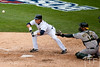 Oct 7, 2012; Detroit, MI, USA; Detroit Tigers left fielder Andy Dirks (12) sacrifice bunts during the eighth inning of game two of the 2012 ALDS against the Oakland Athletics at Comerica Park.  Mandatory Credit: Tim Fuller-US PRESSWIRE