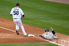 Oct 7, 2012; Detroit, MI, USA; Oakland Athletics shortstop Cliff Pennington (2) slides into first base as Detroit Tigers starting pitcher Doug Fister (58) gets the force out during the fourth inning of game two of the 2012 ALDS at Comerica Park.  Mandatory Credit: Tim Fuller-US PRESSWIRE