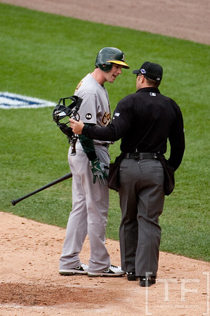 Oct 7, 2012; Detroit, MI, USA; Oakland Athletics shortstop Stephen Drew (5) argues a call with home plate umpire Mark Wegner during the third inning of game two of the 2012 ALDS against the Detroit Tigers at Comerica Park.  Mandatory Credit: Tim Fuller-US PRESSWIRE