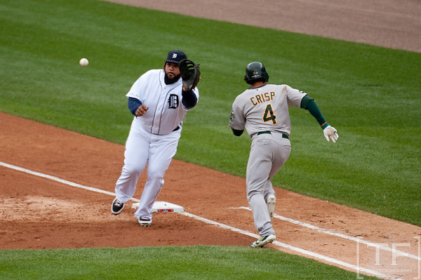 Oct 7, 2012; Detroit, MI, USA; Oakland Athletics center fielder Coco Crisp (4) is safe at first base as Detroit Tigers first baseman Prince Fielder (28) is unable to make the play during the third inning of game two of the 2012 ALDS at Comerica Park.  Mandatory Credit: Tim Fuller-US PRESSWIRE