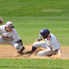 Monty Tech's #11 Ben Gauvin slides safely under the tag of the Worcester North second baseman during the game at Monty Tech on Thursday afternoon. SENTINEL & ENTERPRISE / Ashley Green
