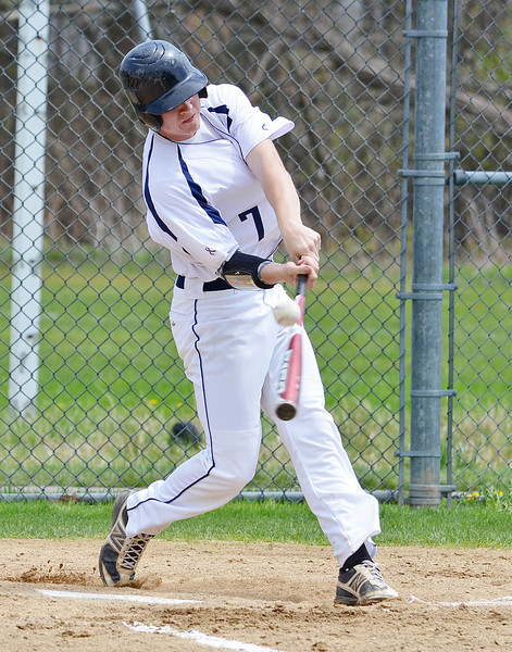 St. Bernard's #7 Sean Maki connects with the ball in the first game of a double header against Hopedale on Saturday afternoon in Fitchburg.  SENTINEL & ENTERPRISE / Ashley Green