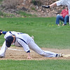 St. Bernard's #1 Dan Grammel stretches to make the play at first in the first game of a double header against Hopedale on Saturday afternoon in Fitchburg.  SENTINEL & ENTERPRISE / Ashley Green