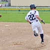 St. Bernard's #22 Brandon Ecklund approaches second base after hitting a double in the first game of a double header against Hopedale on Saturday afternoon in Fitchburg.  SENTINEL & ENTERPRISE / Ashley Green
