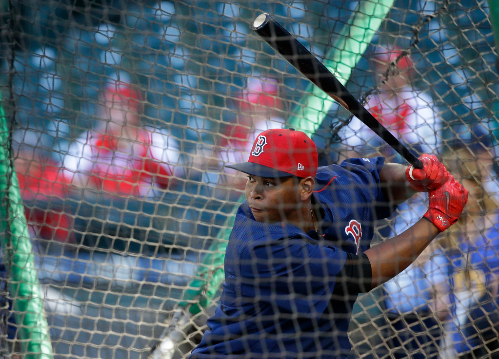 . Boston Red Sox third baseman Rafael Devers takes batting practice before a baseball game against the Seattle Mariners, Monday, July 24, 2017, in Seattle. (AP Photo/Ted S. Warren)