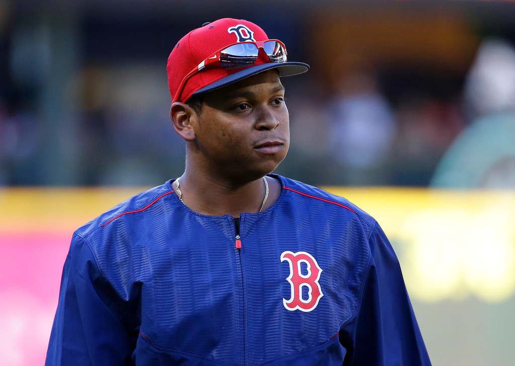 . Boston Red Sox third baseman Rafael Devers walks on the field during batting practice before a baseball game against the Seattle Mariners, Monday, July 24, 2017, in Seattle. (AP Photo/Ted S. Warren)