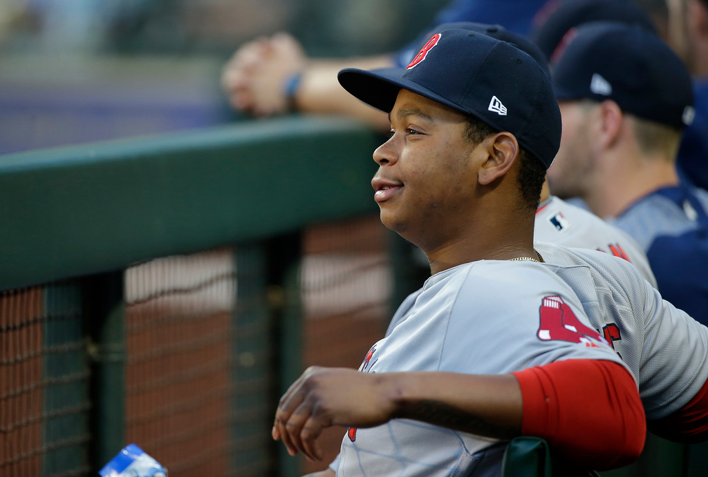 . Boston Red Sox third baseman Rafael Devers sits in the dugout during the second inning of a baseball game against the Seattle Mariners, Monday, July 24, 2017, in Seattle. (AP Photo/Ted S. Warren)