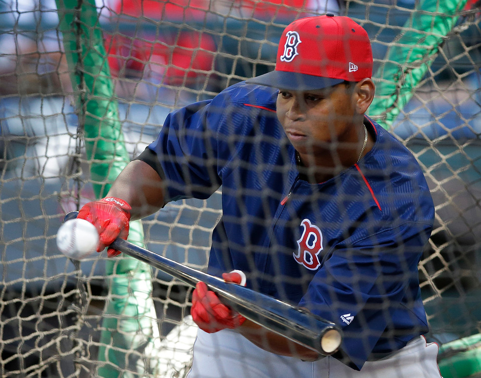 . Boston Red Sox third baseman Rafael Devers bunts during batting practice before a baseball game against the Seattle Mariners, Monday, July 24, 2017, in Seattle. (AP Photo/Ted S. Warren)