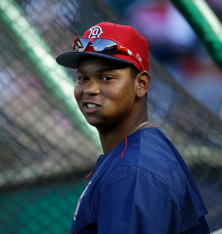 . Boston Red Sox third baseman Rafael Devers stands near the cage during batting practice before a baseball game against the Seattle Mariners, Monday, July 24, 2017, in Seattle. (AP Photo/Ted S. Warren)