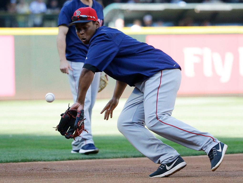 . Boston Red Sox third baseman Rafael Devers fields a ball at third base during batting practice before a baseball game against the Seattle Mariners, Monday, July 24, 2017, in Seattle. (AP Photo/Ted S. Warren)