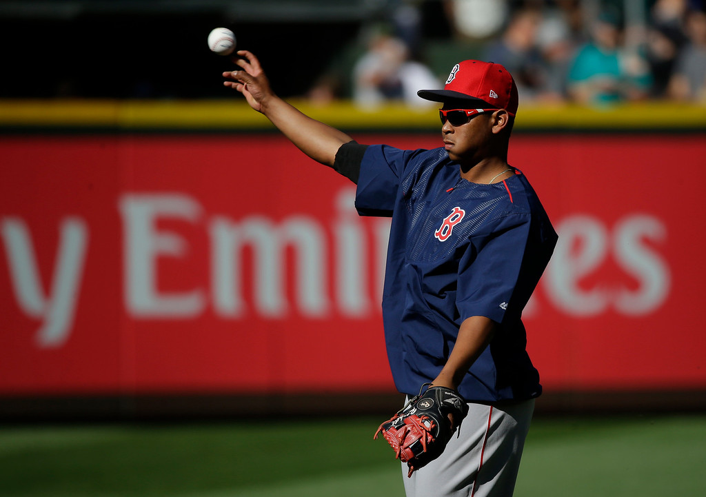 . Boston Red Sox third baseman Rafael Devers throws the ball during batting practice before a baseball game against the Seattle Mariners, Monday, July 24, 2017, in Seattle. (AP Photo/Ted S. Warren)