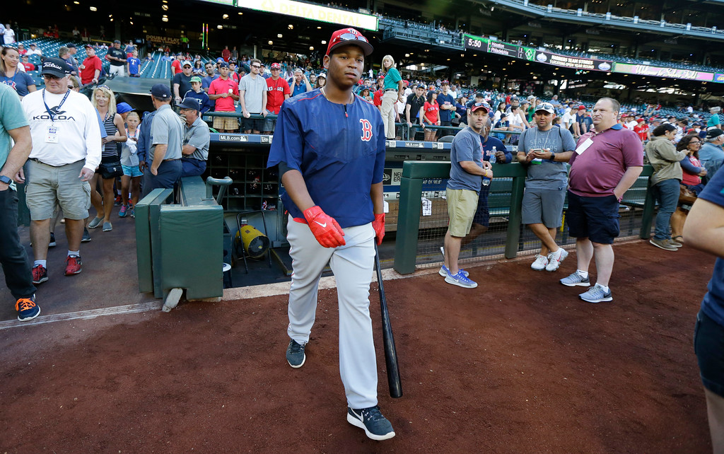 . Boston Red Sox third baseman Rafael Devers walks out of the dugout for batting practice before a baseball game against the Seattle Mariners, Monday, July 24, 2017, in Seattle. (AP Photo/Ted S. Warren)