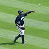 Nyjer Morgan returns a fly ball.
