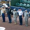 Representatives from the armed forces threw out the first ball