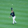 Norichika Aoki catches a fly ball.