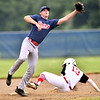 WARREN  DILLAWAY | Star Beacon <br /> Gordon Seger, of the Bruisers, leaps for the ball as Anthony Arkey slides safely into third base for the Elite on Friday evening during American Legion action at Grand River Academy.