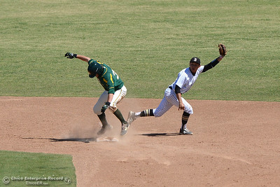 Alex Gonzalez holds the ball in his glove after tagging second to get Feather River's Jeremy Peterson out in the fifth inning on an assist from Roadrunner right fielder Jackson Murphy as Butte College plays baseball Saturday, April 16, 2016, against Feather River College at Cowan Field in Butte Valley, California. (Dan Reidel -- Enterprise-Record)
