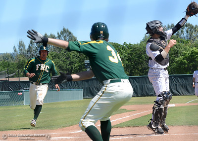 Feather River's Daniel Frentiss stays to his right to score as guided by teammate Jeremy Peterson (34) as Butte College plays baseball Saturday, April 16, 2016, against Feather River College at Cowan Field in Butte Valley, California. (Dan Reidel -- Enterprise-Record)