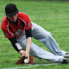 Globe/Roger Nomer<br /> Aurora's Tristan Dunning makes a play on a ground ball during Tuesday's game at Carl Junction.