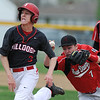 Globe/Roger Nomer<br /> Carl Junction's Tyler Armentrout avoids the tag from Aurora's Dallas Peterson as he runs back to first base during Tuesday's game at Carl Junction.