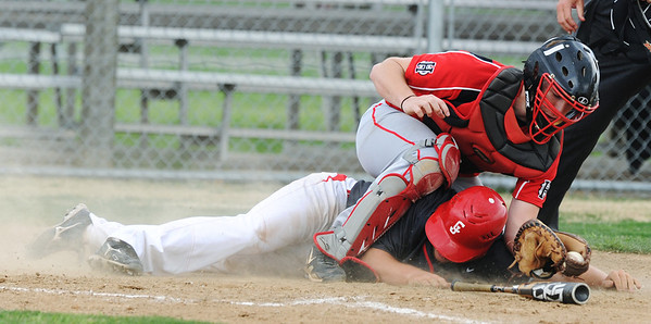 Globe/Roger Nomer<br /> Aurora's Nathan Mueller tags out Carl Junction's Branche McGriff at the plate during Tuesday's game at Carl Junction.