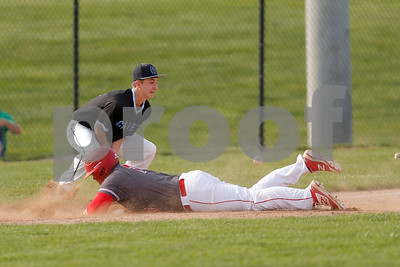 Plainfield High School first baseman Brady Adams  (18) with the head first slide into third for a triple during the game between Cascade vs Plainfield at  Plainfield  High School in Plainfield,IN. (Jeff Brown/Flyer Photo)