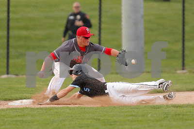 Cascade High School second baseman AJ Sanders  (5) slides safely into third just ahead of the through to Plainfield High School third baseman Brady Adams  (18) during the game between Cascade vs Plainfield at  Plainfield  High School in Plainfield,IN. (Jeff Brown/Flyer Photo)