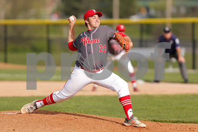 Plainfield High School pitcher Sam Tackett  (20) brings the heat the to plate during the game between Cascade vs Plainfield at  Plainfield  High School in Plainfield,IN. (Jeff Brown/Flyer Photo)