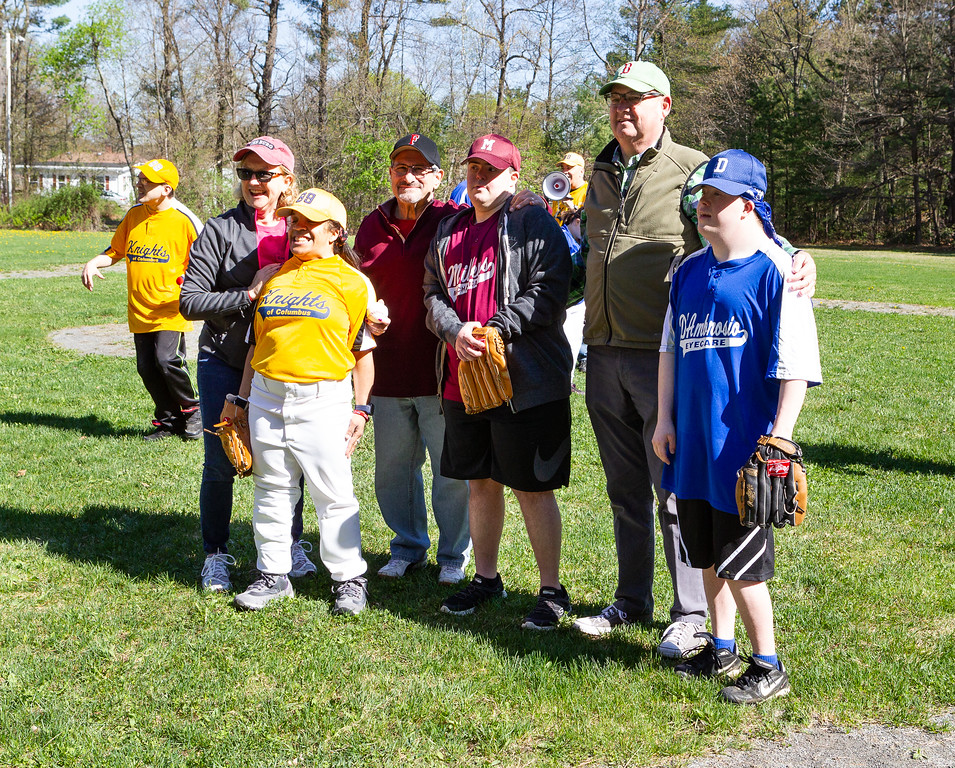 . Fitchburg City Councilor Elizabeth Walsh, Mayor Stephen DiNatale, center, and state Rep. Stephan Hay pose with players during opening day for Challenger Little League at Coggshall Park in Fitchburg on Saturday, May 5, 2018. SENTINEL & ENTERPRISE PHOTOS / GARY FOURNIER