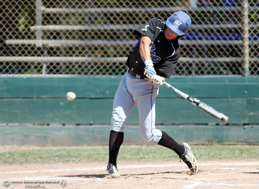 . Chico Nuts\' #7 Ryan Souza knocks a single against Redding Tigers in the top of the first inning during their American Legion baseball game at Doryland field Friday, July 19, 2013 in Chico, Calif.  (Jason Halley/Chico Enterprise-Record)