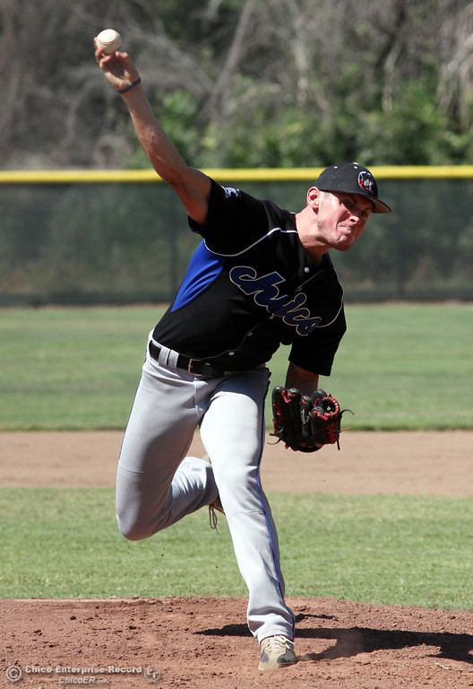 . Chico Nuts\' #4 Clayton Schuler pitches against Redding Tigers in the bottom of the first inning during their American Legion baseball game at Doryland field Friday, July 19, 2013 in Chico, Calif.  (Jason Halley/Chico Enterprise-Record)