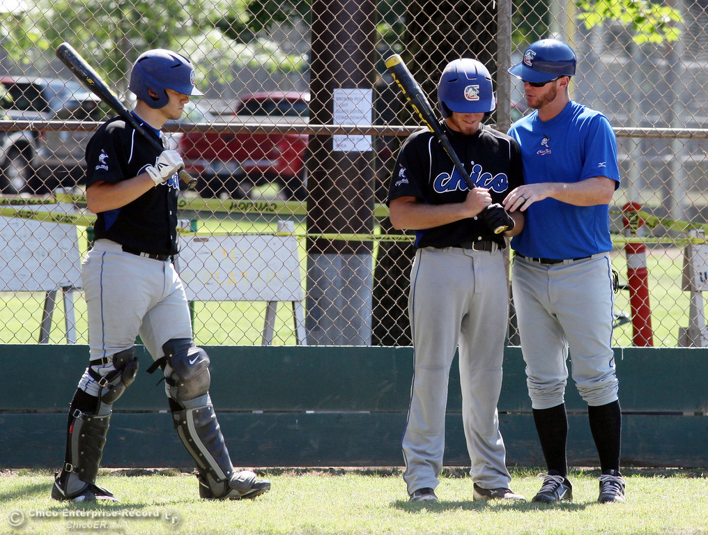 . Chico Nuts Assistant Head Coach Brian Thomas (right) talks to #33 Andrew Shippelhoute (center) against Redding Tigers in the top of the second inning during their American Legion baseball game at Doryland field Friday, July 19, 2013 in Chico, Calif.  (Jason Halley/Chico Enterprise-Record)